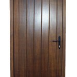 Boarded and dark stained exterior door